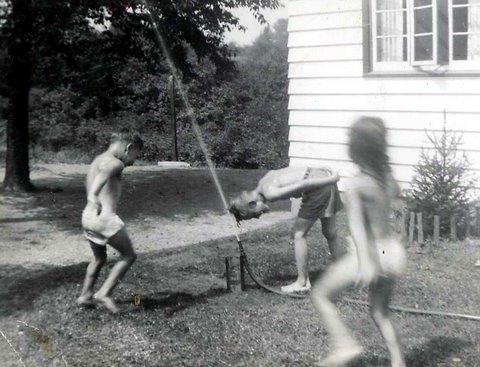 Kids under sprinkler